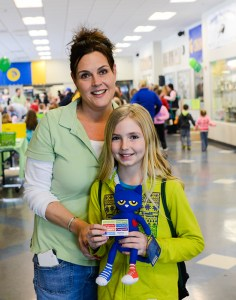 Angie Taylor with Sydney Gage of Custer, who found Pete the Cat