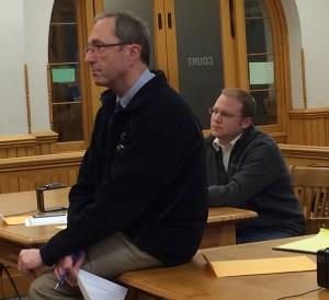 Prosecutor Paul Spaniola and defense attorney David Glancy speak to a cadet.