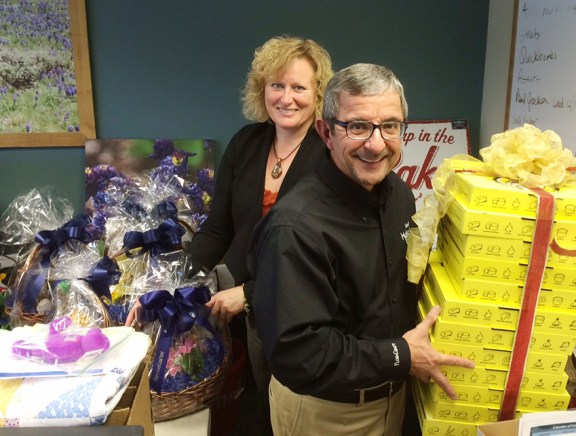 Conny Bax and Jim Scatena sort through the many items that have been donated for the auctions.