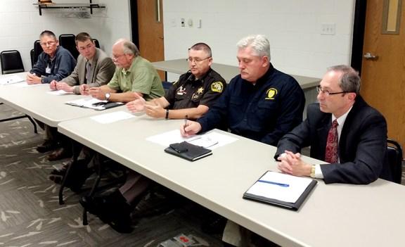 From left: Dr. Kohx; MSP Det. Sgt. Johnson; SPD Chief Don Riley; Sheriff Cole; LPD Chief Barnett; Prosecutor Spaniola.