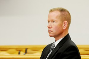 Sammy Seymour watches testimony.