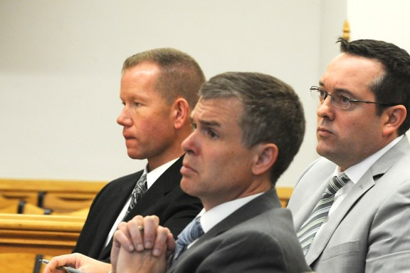 Attorney Mike Nichols, front, along with Seymour, left, and attorney Gary Springstead, during the May 2015 trial.