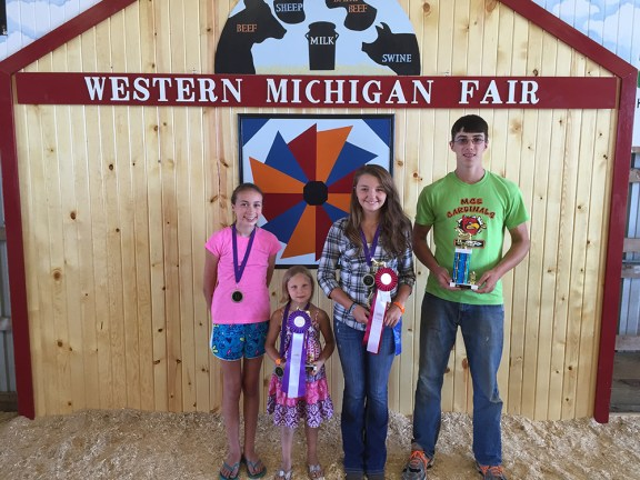 From left: Rachel Doyle, best of breed - pigmy; Brailyn Johnson, best of breed - Nigerian dwarf, grand champion overall (goats of all breeds); Abbie Berringer, overall, best of breed Boer, reserve champion market; Abe Shoup, best utter. Missing: Kayle Berringer, grand champion market.