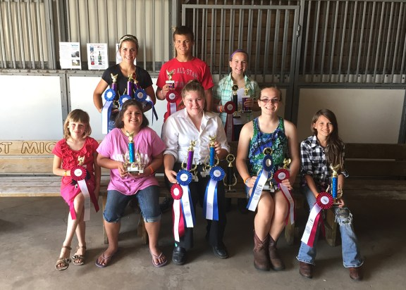 Poultry showmanship. Front row, from left: Amelia Malburg, second place beginner chickens; Mallory Oomen, first place beginner chickens; Alexandrea Root, intermediate — first place chicken, second place duck, first place turkey; Audra Shoop, intermediate — first place ducks, second place turkeys; Adrianna Malburg, intermediate, second place chickens. Back row, from left: Amy Grace Shoop, senior — first place chicken, duck and turkey; Jacob Shoup, senior — second place chicken; Andrea Shoup, senior — second place turkey and duck.