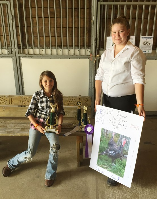 From left: Adrianna Malburg, best in show poultry; Alexandria Root, grand champion turkey and grand champion duck.