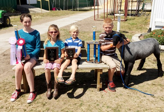 From left: Ella Stone, reserve champion overall; Lucy Shoup and Afton Shoup, rate of gain co-champions; Alex Tyndall, overall champion.
