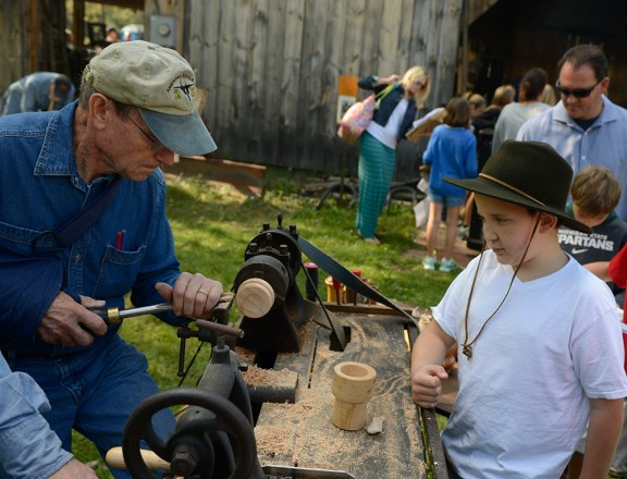 Norm Letsinger of Custer Township demonstrates wood turning.