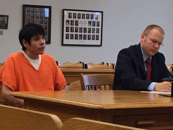 Carlos Lopez with his attorney, David Glancy.