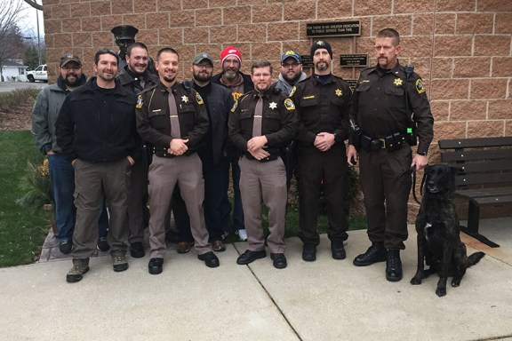 Front row, from left: Detective Mike Kenney, Dep. John Balowski, Dep. Mike Fort, Dep. Ed Rasmussen, Dep. Ken Baum, K-9 Cash. Back row, from left: Sgt. Oscar Davila, Sgt. Adam Lamb, Sgt. Derrek Wilson, Dep. John Long, Dep. Matt Warmuskerken.