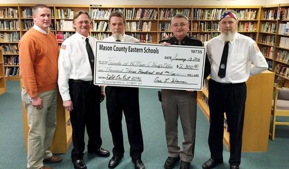 From left: Eric Sherman, MCE; Greg Root and Mark Trim, VFW; Sheriff Kim Cole; Dan Trim.