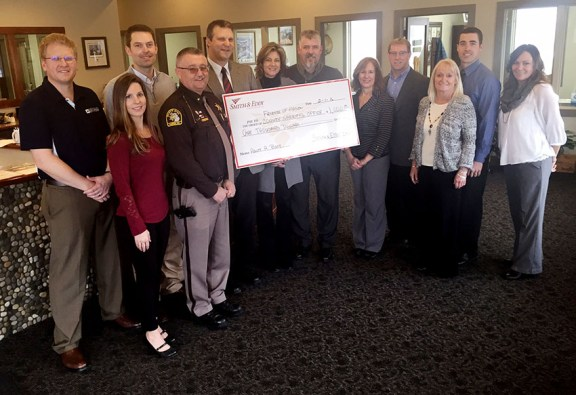 Smith & Eddy Insurance donated to The Boot project this morning. Employees presented a check to Sheriff Cole, along with school superintendents Jeff Mount (MCC), Andrea Large (LAS) and Paul Shoup (MCE). Photo by Becky Alway.
