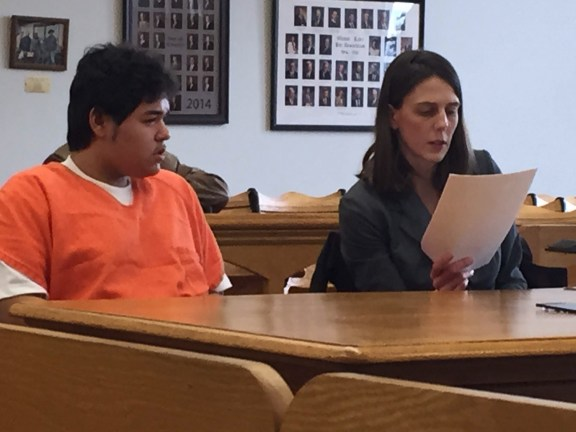 Isaiah Pena with his attorney, Becky Lederer.