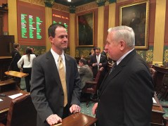 Speaker Kevin Cotter, left, speaks with Rep. Franz.