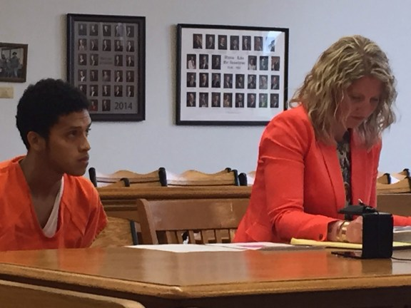 Carlos Gomez with his attorney, Kari Russell.