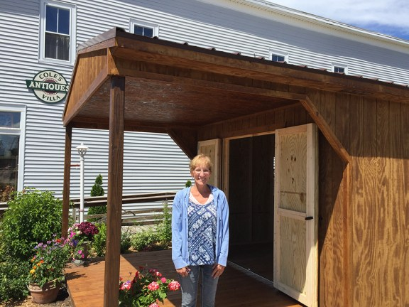 Sally Cole stands outside the new retail space.
