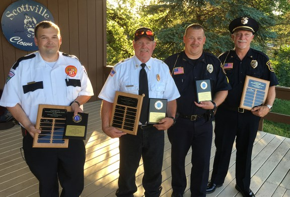 From left: Jim Herrema, Dale Larr, Jason Williams and Scottville Police Chief Don Riley.