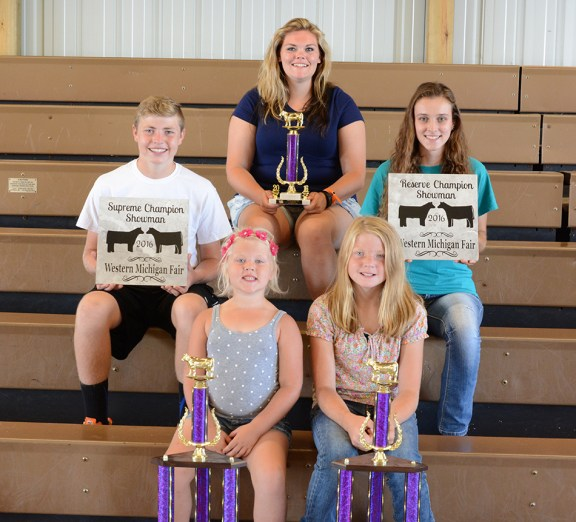 In front, from left: Isabel Babbin, champion overall female; Briana Crawford, champion cow calf pair. Second row: Overall showman: Ryan Crawford, first, Samantha Wilkosz, second. Third row: Brooke Lee, homegrown.