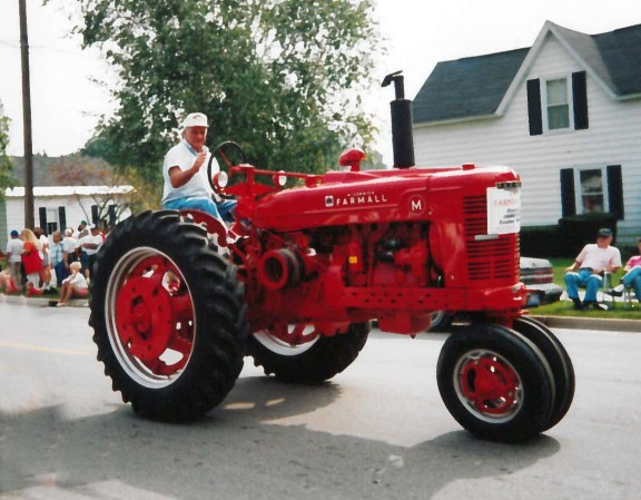 Jim Howe on his Farmall tractor.