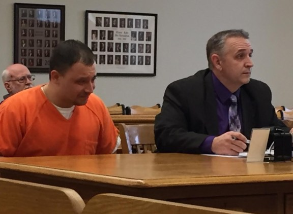 Gary Maccune weeps during his sentencing in circuit court. Pictured at right is his attorney, Al Swanson, Jr.