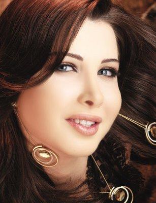 نانسي عجرم سعيدة بنتيجة مباراة مصر والجزائر وتهدي المنتخب المصري اغنية   فيديو