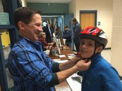 Milton Bike fits helmets donated by Breakstone, White & Gluck's Project KidSafe campaign for children at Celebrate Milton in October.