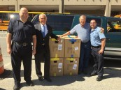 Attorney Ronald E. Gluck and Attorney David W. White with members of the Malden Police Department, which received 100 helmets from our Project KidSafe campaign.