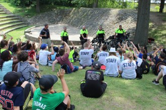Quincy Police Department bike officers answer questions from the 5th graders.