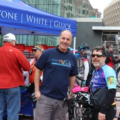 Attorney Marc L. Breakstone with a cyclist at our Project KidSafe tent.