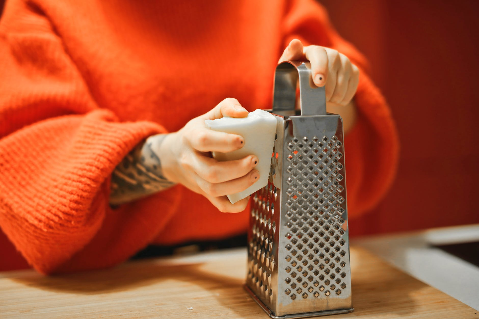 person holding grater