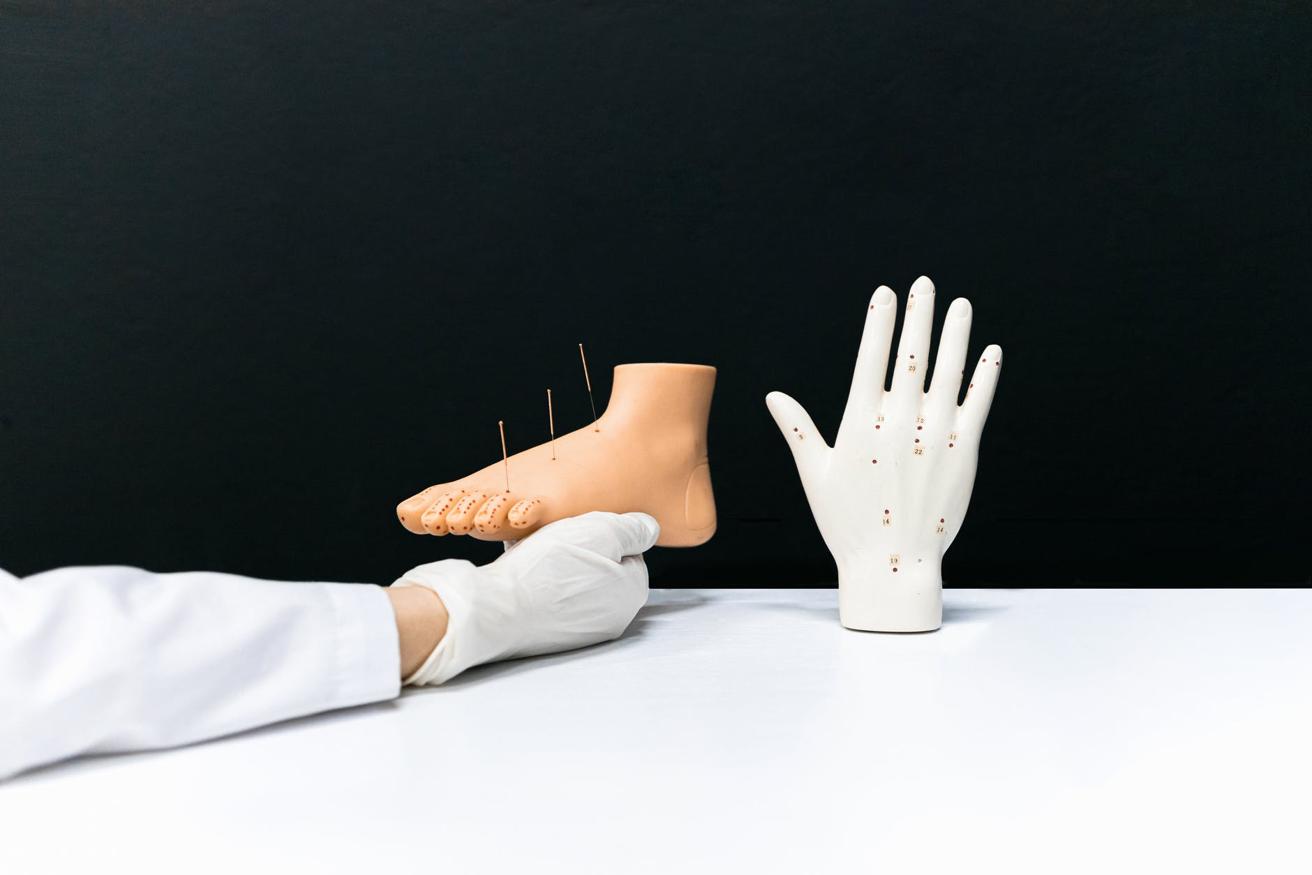 person wearing white gloves with brown gloves