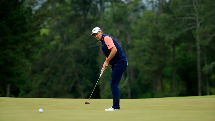 Justin Rose putts on No. 18 during the third round of the 2018 Masters.