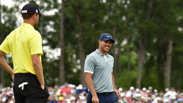 Brooks Koepka and Webb Simpson finish play at No. 18 during the final round of the 2019 Masters.