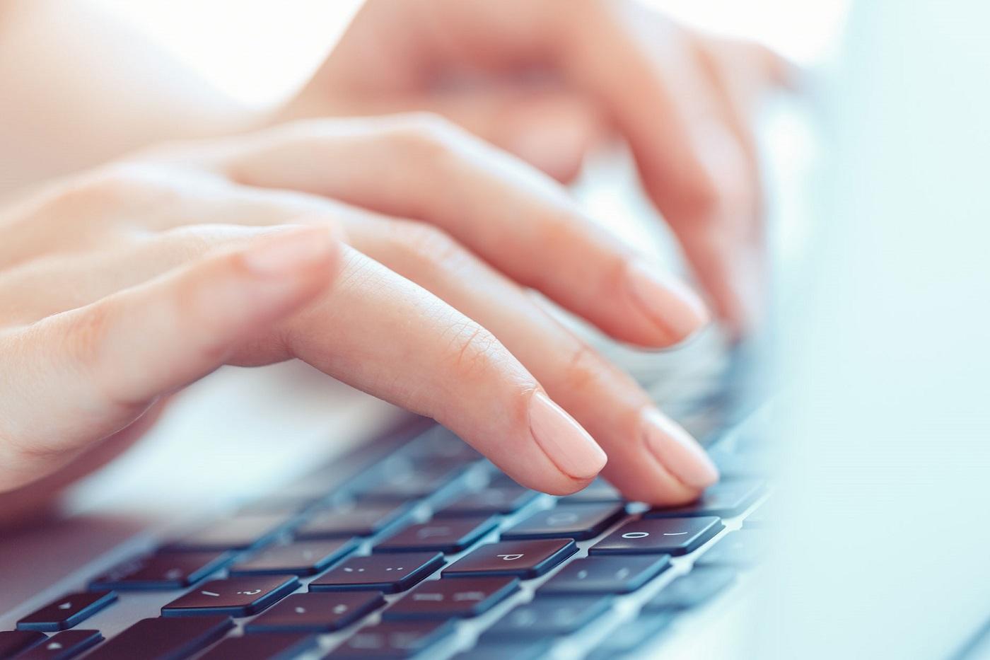 finance-translation-finance-language-solutions-female-hands-typing-laptop-keyboard_1400x933