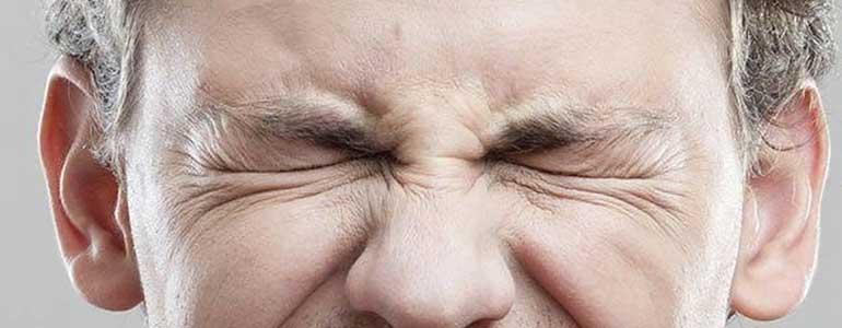 Συμπτώματα του βλεφαροσπασμού
