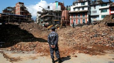 From BBC: An excavator is used to dig through rubble in search of bodies in Kathmandu