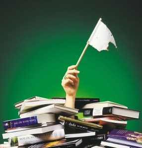(AUSTRALIA & NEW ZEALAND OUT) A pile of books and hand holding white flag, 22 November 1997. AFR Photo-Illustration by PATRICK CUMMINS / (Photo by Fairfax Media via Getty Images)