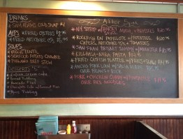 The daily specials are written on the chalkboards on the walls.