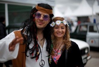 MADRID, SPAIN - JUNE 09: Two people dressed as hippies pose for a picture at the Jarama Circuit on June 9, 2013 in Madrid, Spain. The Jarama Vintage Festival seeks to revive the 1960s, 70s and 80s attracting classic cars and motorbikes against a background of public orientated activities and shows. (Photo by Pablo Blazquez Dominguez/Getty Images)