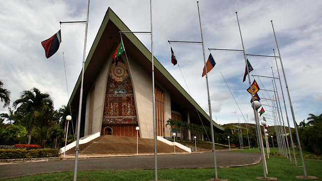 The Parliament Building and flags of PNG's provinces (Credit: ABC)