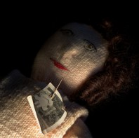Knitted Poppet with Photograph. © Sara Hannant. Of Shadows: One Hundred Objects From The Museum Of Witchcraft and Magic (2016) The pin that pierces the woman's face in the photograph suggests a desire to cause her harm. Possibly this intention is also invested in the knitted body. It is thought that knitting is like ancient knot magic where magical will or force can be invested into each stitch. In witchcraft, magic is practiced to bring about transformation and sometimes objects are made or charged with magical intent for this purpose. Similarly, the photographic process can transform objects, images and ideas that contribute to their meaning. While artist-in -residence at the Museum of Witchcraft and Magic in Cornwall, I became fascinated to explore how light and darkness define and articulate our relationship to enchantment and if this mechanism can be employed to suggest narrative and significance. Sarah Hannant, Photographer, www.sarahannant.com