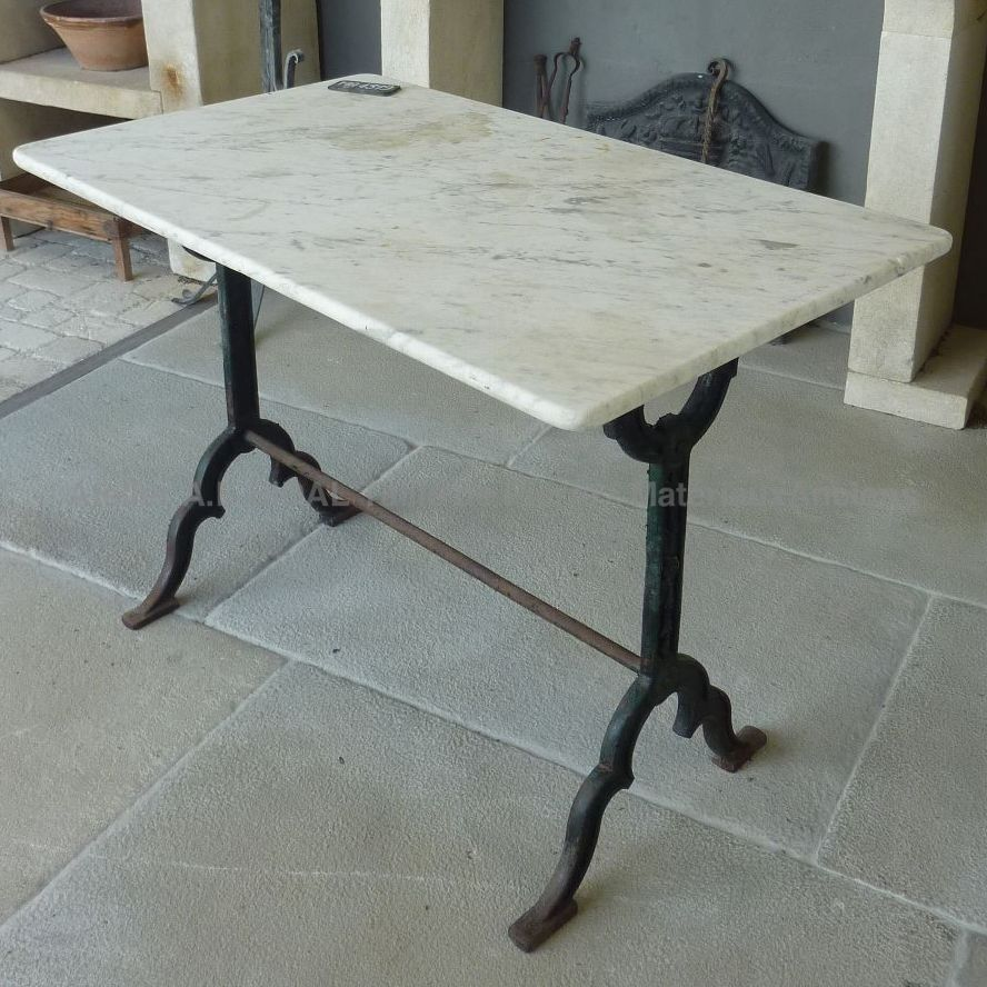 table made of marble and wrought iron