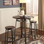 Challiman Rustic Brown 3 Pc Round Dining Room Bar Table 2 Tall Stools Mathis Brothers Furniture