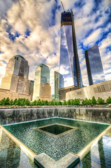 Freedom_Tower_in_Progress_and_National_September_11_Memorial_South_Pool