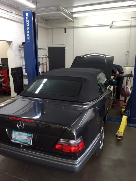 Mercedes E320 being diagnosed by experienced mechanic