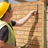 Bricklayer Pointing Bricks