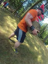 Carry a 90 pound cement chunk 20 yards, 5 burpees carry the block back.