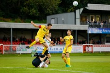 AUGUST 08: Dover Athletic v Bromley FC in Conference Premier at Crabble Stadium in Dover, England. Bromely's Jack Holland rises above a floored Dover's forward Ryan Bird to clear the ball. (Photo by Matt Bristow/mattbristow.net)