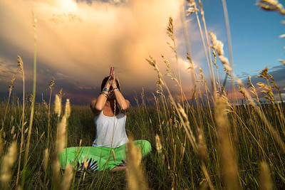 Yoga portrait session outside of Denver, Colorado. Nothing like taking advantage of a wheat field and a building storm to make a great outdoor portrait session.