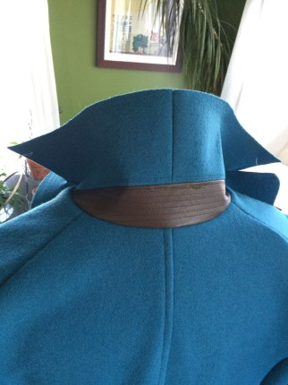 Leather collar stand accent with sewn-on interfacing as seen in reference photos