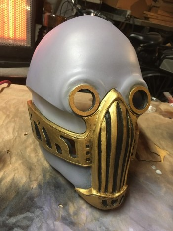 "Using ""gold leaf"" Rub-n-buff on the respirator and eyes"